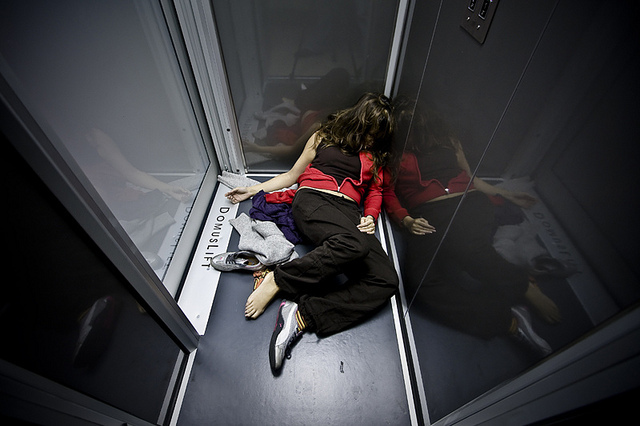 Girl collapsed passed out in elevator photo by Luca Rossato on Flickr
