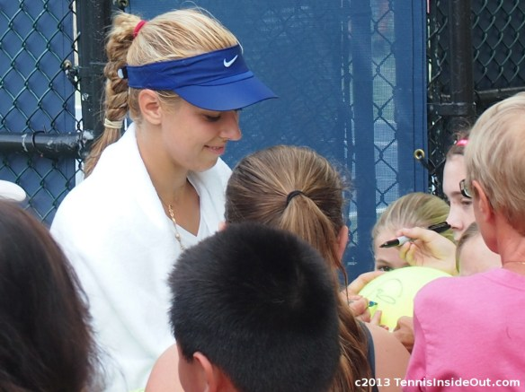 Sabine Lisicki with fans after practice smiling Cincinnati Western and Southern Open
