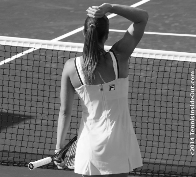Jelena Jankovic Cincinnati match hand on top of head yellow Fila dress photos b&w