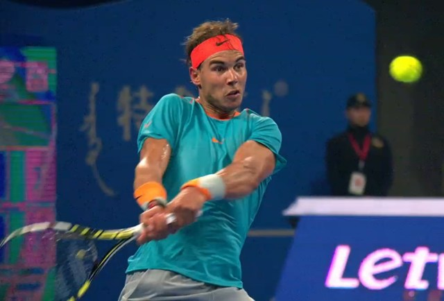 Rafael Nadal cranking hard backhand tennis ball wide eyes intense tiebreak Klizan match Beijing 2014