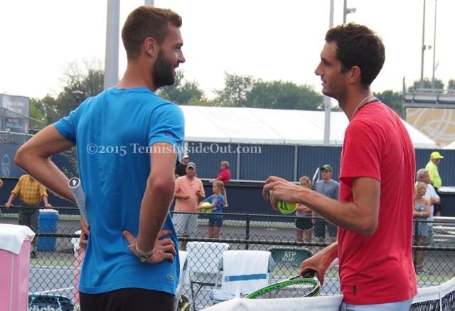 Benoit Paire hands on hips James Ward gesturing Cincinnati Masters practice tennis at net