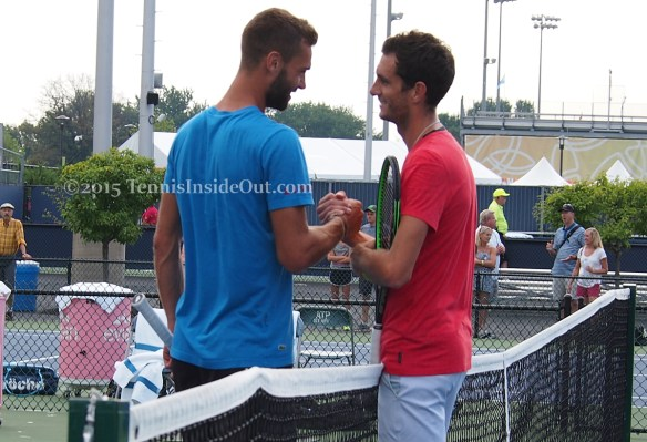 Benoit James handshake clasping hands at net smooshy