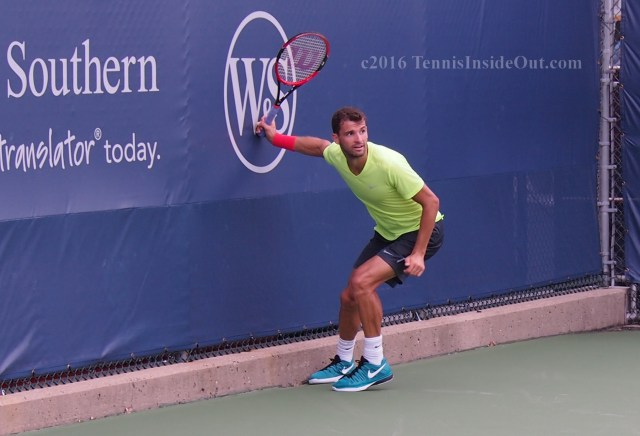 Dimitrov grabbing wall after running down shot practice with Borna Coric pics