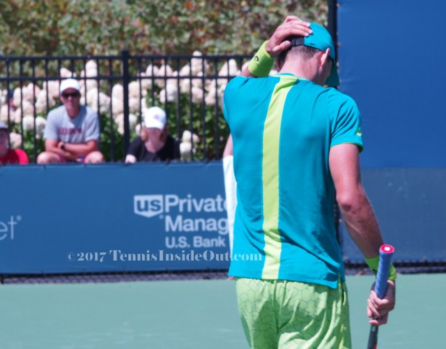 Western and Southern Open Pospisil loss clutching head rough match photos