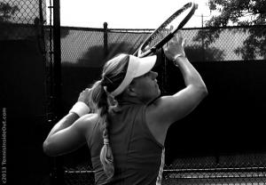 Angelique Angie Kerber lining up overhead smash Cincinnati Open practice visor braid racquet photos pictures by Valerie David 2013