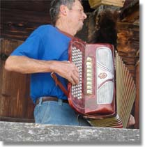 Accordion player Rudy at Roy Emerson Tennis Week picnic, Gstaad, Switzerland