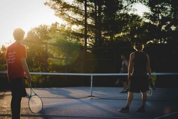 photo of three men playing tennis