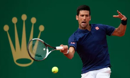 Djokovic squeezes through