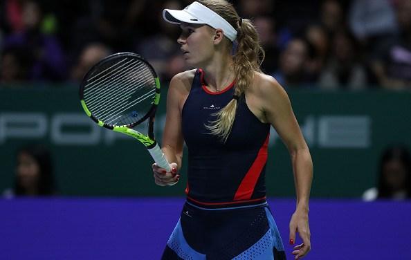 Singapore   Wozniacki and Kvitova both fall in openers