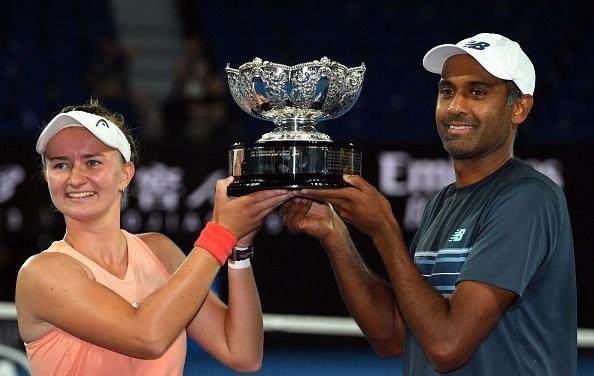 Melbourne | Krejcikova and Ram lift Mixed Doubles trophy