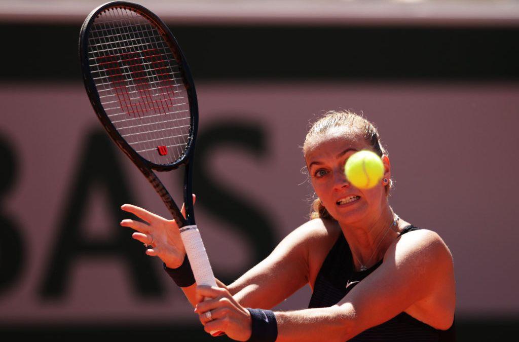 Kerber falls as Kvitova survives scare