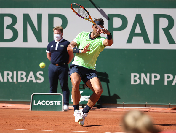 Nadal and Djokovic clear first hurdles comfortably