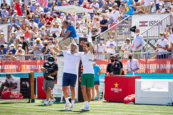 Djokovic forced out but Medvedev sails on