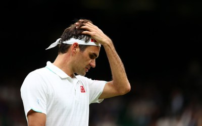 Federer survives as Mannarino falls