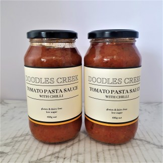 Two Jars of tomato pasta sauce on a white background