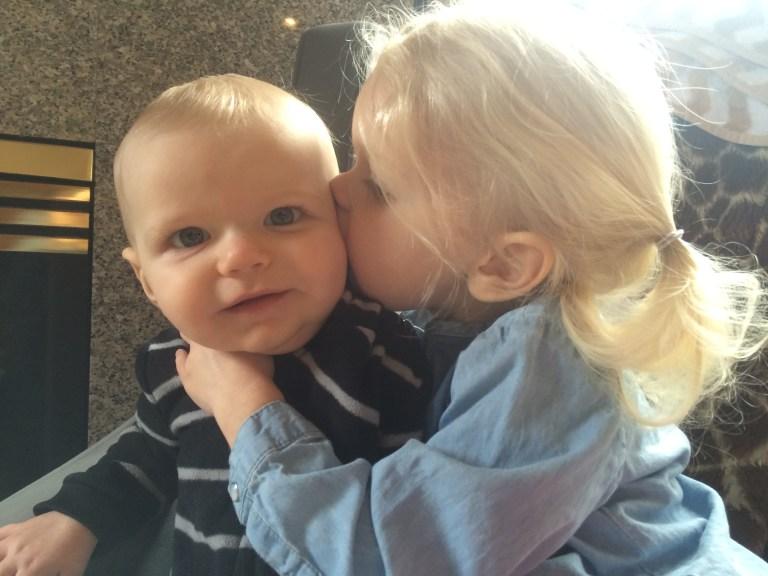 Sisters kiss Ten Thousand Hour Mama