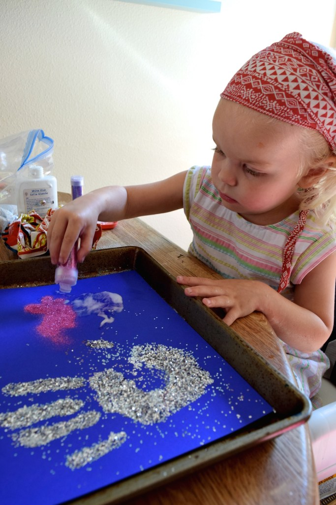 This glitter handprint craft is fun for kids to make - and perfect for a Christmas gift! Ten Thousand Hour Mama