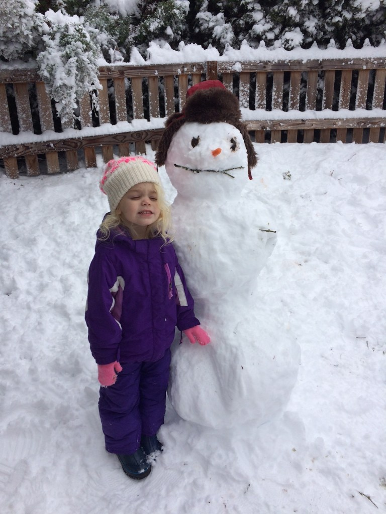 My daughter was so proud of our family's first snowman. Ten Thousand Hour Mama
