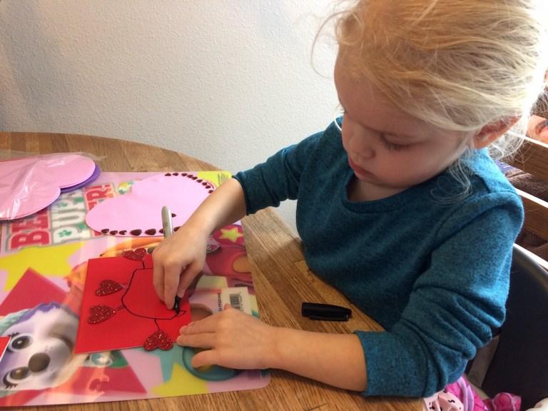 Hard at work on her preschooler Valentine's Day craft