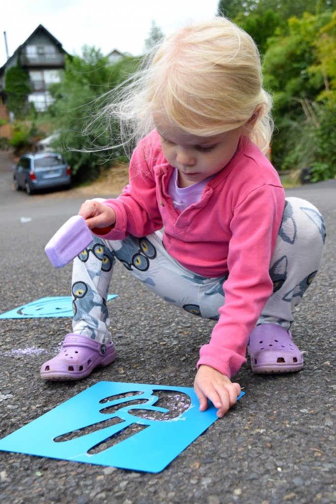 Chalk stencils are a ton of fun for outdoor kids play! Ten Thousand Hour Mama