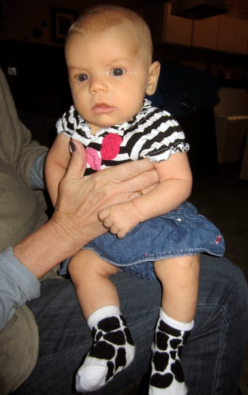 Edith's first time wearing ruffles and anything pink was short: Baby puke necessitated a wardrobe change.