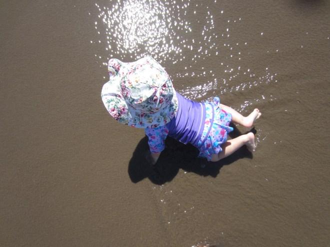 Toddler in ocean - Ten Thousand Hour Mama