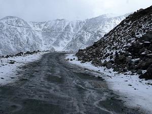 Rough steep snowy - the road to Khardung La Pass, Ladakh India