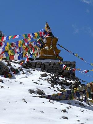 Prayer flags adorn the small stupa on Khardung La Pass