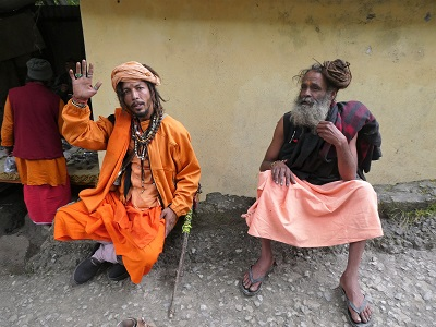Sadhu's (wandering saints) near the rock bridge Mana village