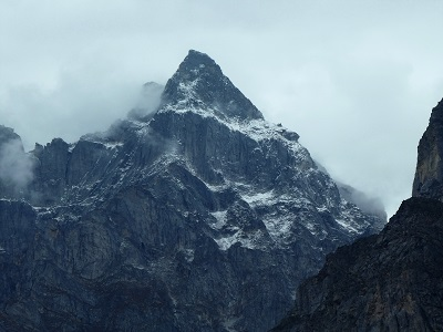 Stunning peak amongst the mist near Badrinath and Mana Village, Himalayas India