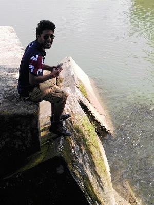Kartik feeding the carp at Baijnath