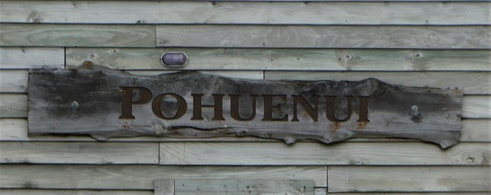 Pohuenui sign on the wall of the shed near the wharf