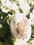 Blattgold bzw. -silber mit Feder kombiniert.
