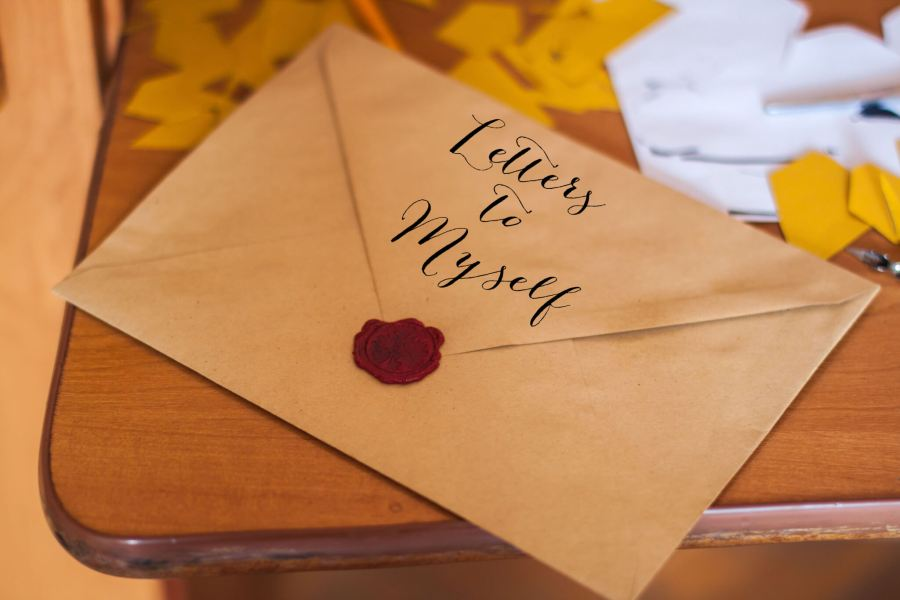 An envelope sitting on a table, with the words Letters to Myself