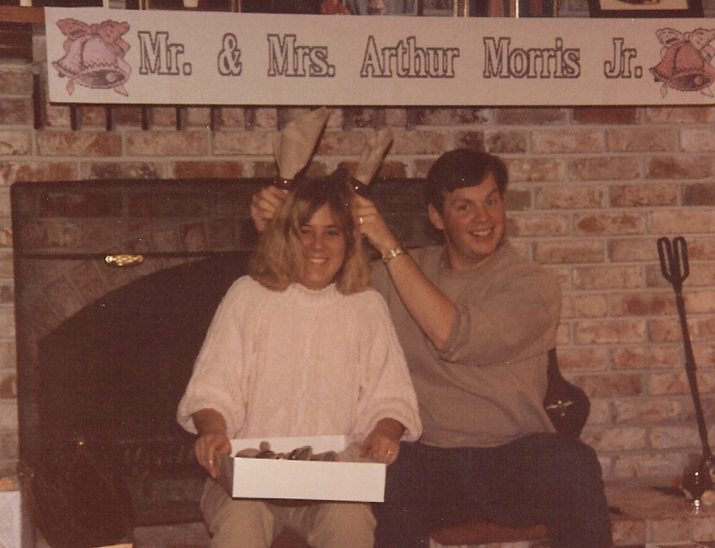 photo of the author and her husband being silly under a banner which reads Mr. & Mrs. Arthur Morris Jr.