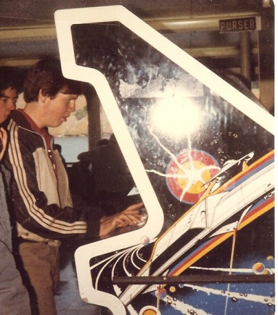 photo of the author's husband in 1983, playing a video game