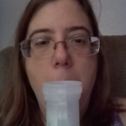 photo of the author using her nebulizer