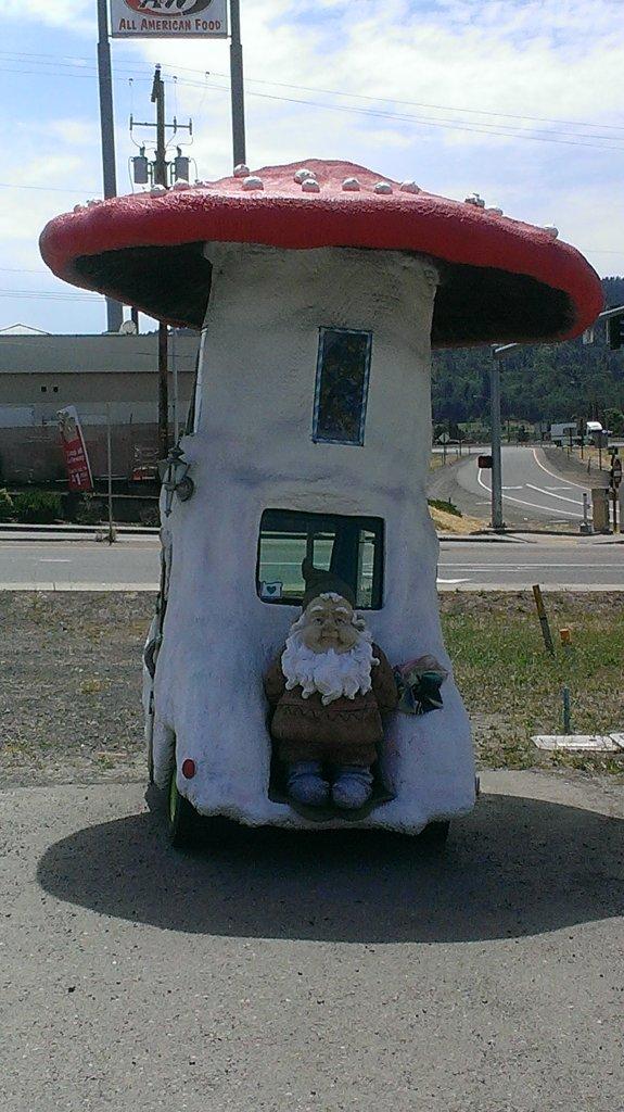 Gnome in front of Magic Mushroom Lamp Company