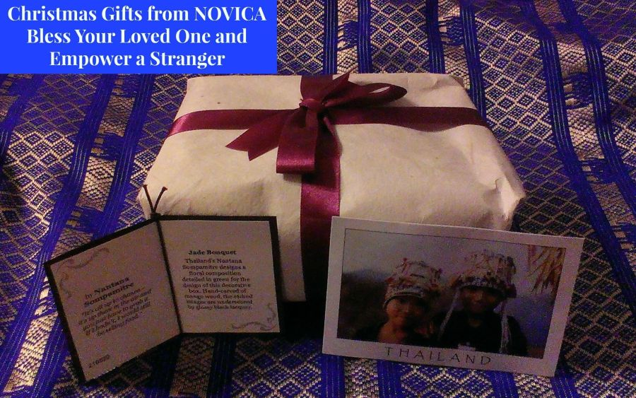 "a photo of two Thai children leans in front of a wrapped gift. Above is the title ""Christmas Gifts from NOVICA - Bless Your Loved One and Empower a Stranger"""