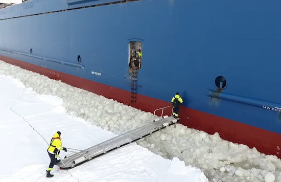 Pilot Is Boarding To Ship Near The Coast Of Hailuoto Finland The Ship Is Going To Port Of Oulu Under Us Was 20 Of Ice