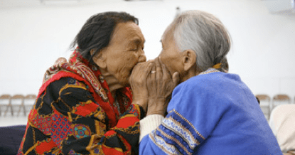Photo credit: CFWE Radio. Elders throat singing. Throat singing was traditionally used to sing babies to sleep or in games women played during the long winter nights while the men were away hunting. Throat-singing was banned in the area over 100 years ago by Christian priests, but it is experiencing a recent revival, especially among younger generations who believe that learning it from their elders connects them with Inuit strength and tradition. Unlike Tuvan throat-singing, the Inuit form of throat-singing is practiced almost exclusively by women.