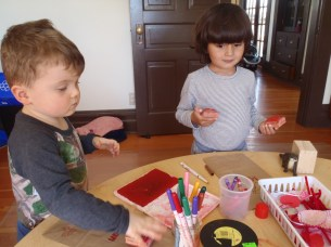 Ronan and Masa decorate their Valentines mail bags.