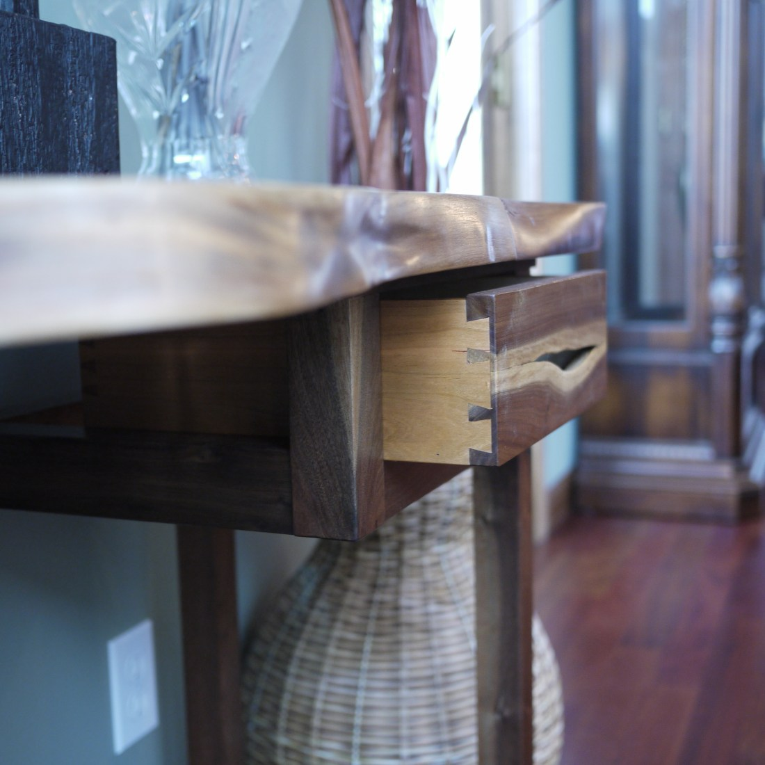 Side view of hall table with live edge handled drawer and half blind dovetail drawer sides
