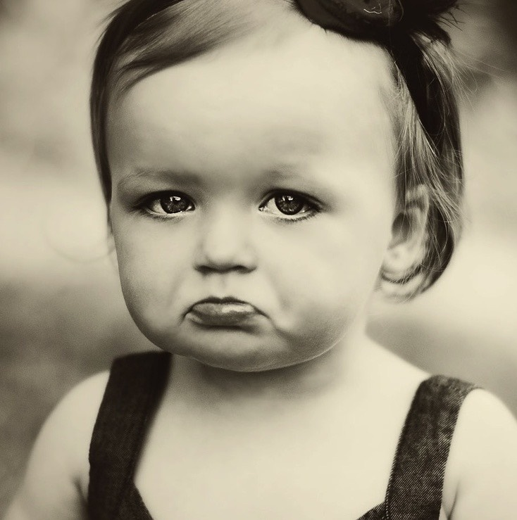 Unhappy child.