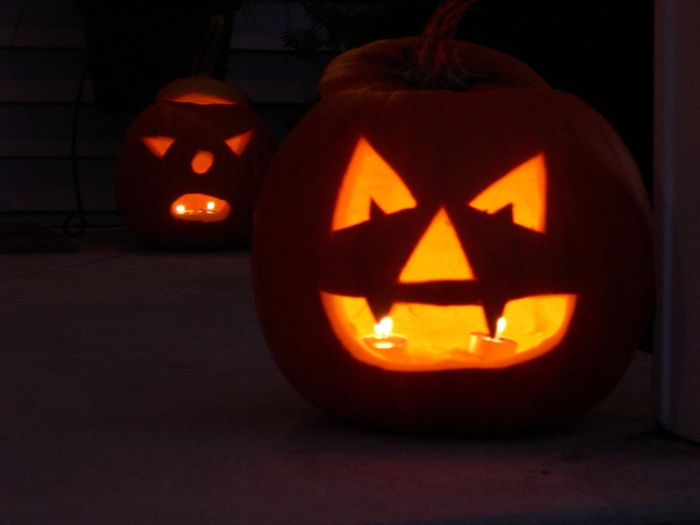 pumpkins lit up on the porch