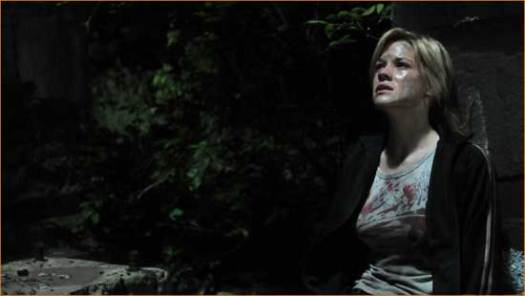 "Amber (Courtney Hope) is on the run in ""Prowl""."