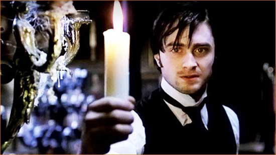 """Arthur Kipps (Daniel Radcliffe) shines a light on the mystery of """"the Woman in Black""""."""