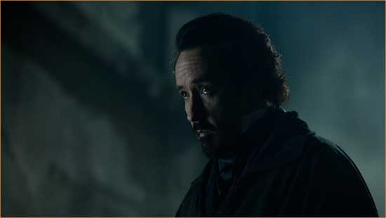 """Poe (John Cusack) ponders once upon a midnight dreary what went wrong with """"The Raven""""."""