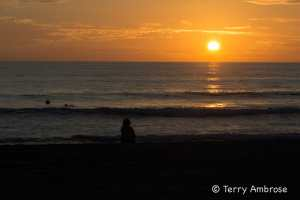 Lone girl watching Carlsbad sunset