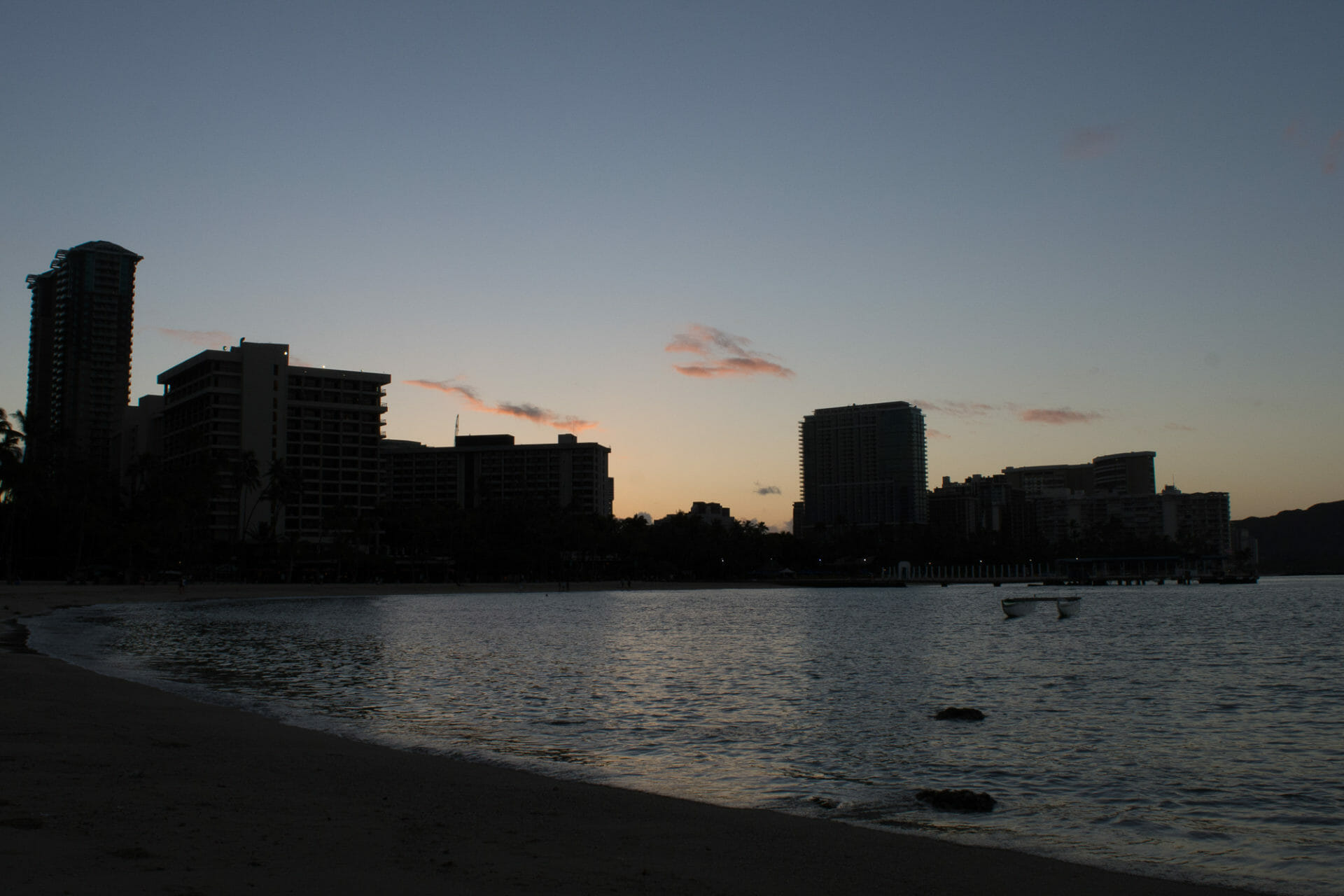 Sunrise looking back toward Waikīkī at Kahanamoku Beach